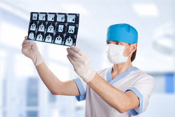medical doctor looking at CT computer tomography scan image in h
