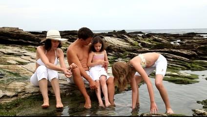 Family shellfishing at low tide