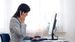 Businesswoman receiving phone call during work