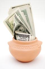 dollars in ceramic pot