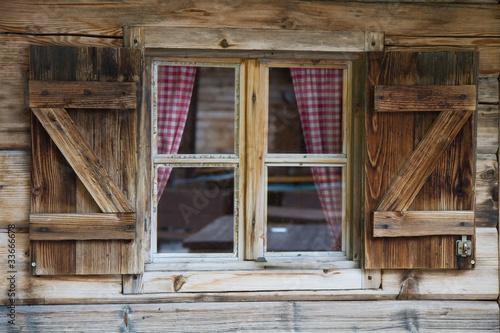 Leinwanddruck Bild Fenster einer Berghütte in Südtirol