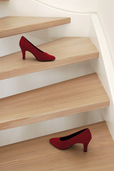 Red shoes on steps of a staircase