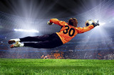 Fototapety Football goalman on the stadium field