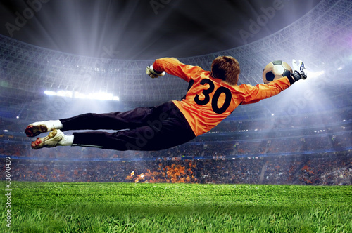 Plexiglas voetbal Football goalman on the stadium field