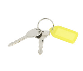 Key with a blank tag closeup on white background
