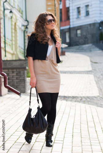 fashionable girl standing on the street
