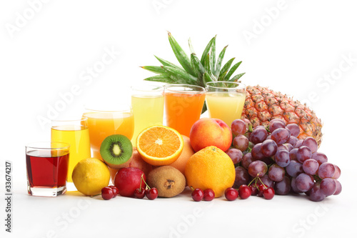 Glasses of fruit juice with fruits