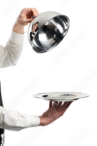 hands of waiter with cloche lid cover - 33674454