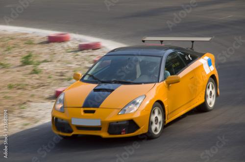 Foto op Canvas Snelle auto s Fast car in a race