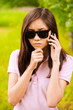 portrait of woman in sunglasses with phone