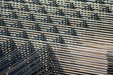 Stacked reinforcing grids in the construction site poster