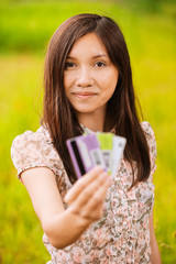 portrait of young woman holding credit cards