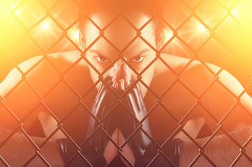 Cage fighter staring at the camera , dramatic lighting