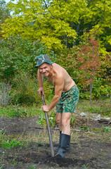 Man digs with spade 4