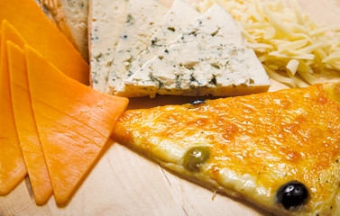 sliced cheeses and pizza
