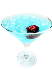 alcoholic blue lagoon cocktail with cherry
