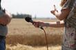 Leinwanddruck Bild - an interview with a farmer