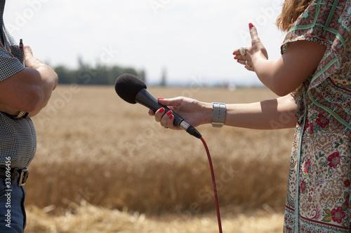 Leinwanddruck Bild an interview with a farmer