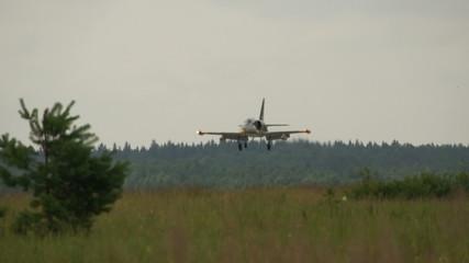 jet fighter landing on air base