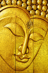 Golden buddha face made by carving wood