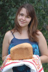 Girl with country home-made bread.Near Kiev,Ukraine