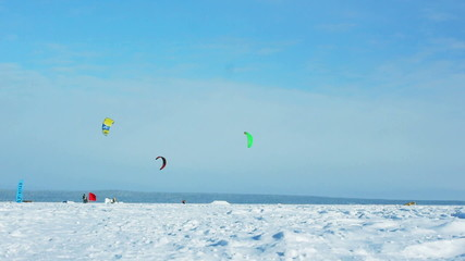 Snow kiting on a frozen lake - winter extreme sport