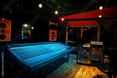 Mixing console in recording studio - 33702272