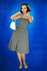 The girl in style 30 on a dark blue background