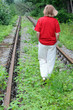 Walking Away Along Abandoned Railroad Track