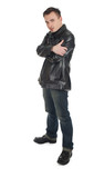 serious young man in leather jacket with crossed arms