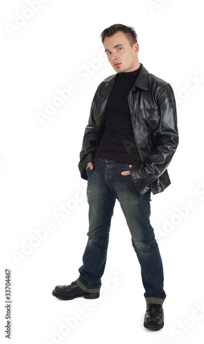 serious young man in leather jacket with hands in pocket.
