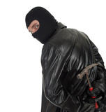 young male thief in balaclava with hammer