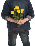 young handsome man holding a yellow roses
