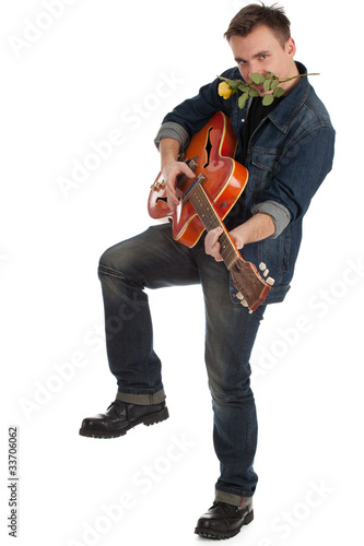 young man with orange electric guitar and yellow rose