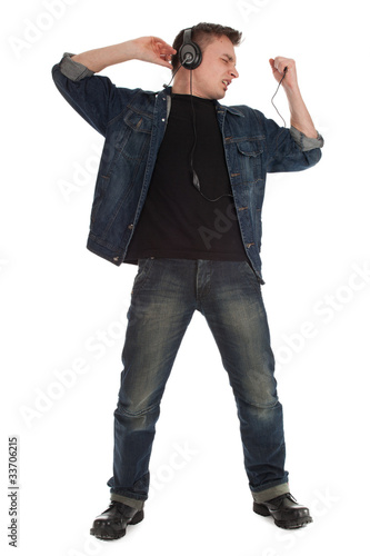 young man in headphones singing and dancing