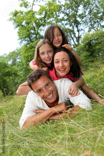 Portrait of happy family in countryside