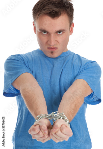 angry, furious young man with handcuffed hands