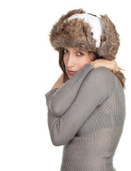 young woman in white winter hat