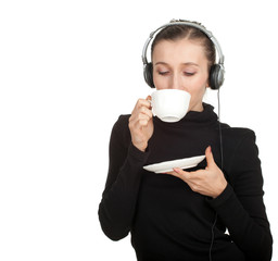 drinking girl in headphones keeping white cup