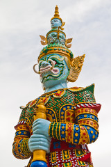 Guardian statue at the temple in Thailand .