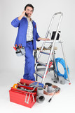 A tradesman with his tools and a stepladder