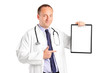 A medical doctor with stethoscope pointing on a clipboard