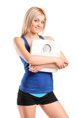 Athlete female holding a weight scale
