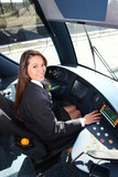 Female tram conductor sat at controls