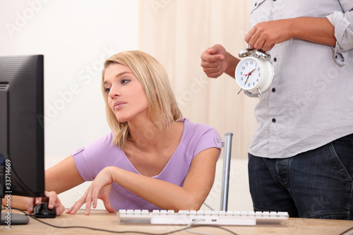 a young blonde woman is doing computer