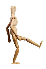 Wooden mannequin kicking isolated on white