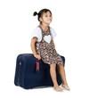 cute girl sitting on luggage