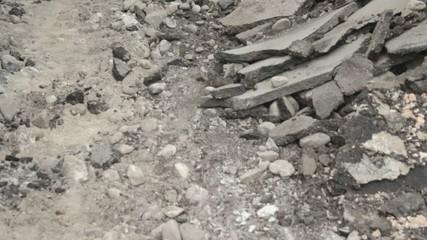 Broken asphalt background, looking bottom-up