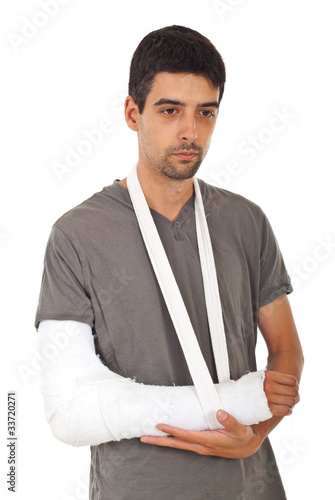 Unhappy man with broken hand thinking