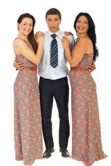 Surprised man holding two laughing women